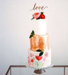 Gold foil + floral wedding cake