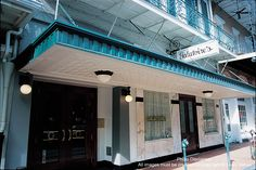 Galatoire's has stood at 209 Bourbon Street for more than 100 years. galatoires-by-louis-sahuc