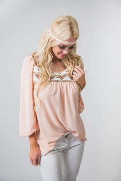 Our adorable Chiffon Blouse with Sequin Detail is perfect for any occasion. It has a flattering flowy fit, sequin Aztec bib giving it a different elegant look, and cinched wrist sleeves. This top will make you look and feel amazing.