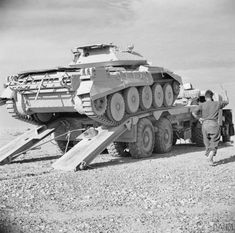 THE BRITISH ARMY IN NORTH AFRICA A Crusader tank being put on a transporter ready to be taken back to the forward areas after receiving repair work at a tank repair depot, 10 December Ww2 Pictures, Military Pictures, Army Vehicles, Armored Vehicles, Crusader Tank, Afrika Corps, Self Propelled Artillery, North African Campaign, British Army
