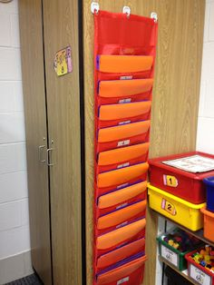 Each student has a math and literacy center folder that holds their center work for the week.  They take these folders to their centers each day.  All center work stays in these folders until Friday when we go over the work as a class.  Anytime a student has extra time they are to check their center folders and finish any unfinished work.  These folders are stored in the pocket charts to prevent a desk full of folders and paper.