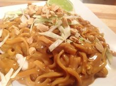 Cold Rice Noodles in Spicy Thai Peanut Sauce Recipe Main Dishes with spaghetti, rice noodles, coconut milk, gluten-free tamari, water, brown rice vinegar, chile sauce, arrowroot, peanut butter, ground ginger, fresh ginger, shredded cabbage, roasted peanuts