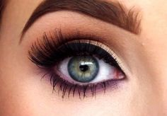 Purple smudged eyeliner makes the eye stand out