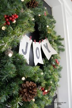 This simple yet sophisticated wreath for your front door is perfect for those of you who prefer traditional Christmas decorations. via The Idea Room