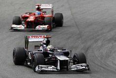 Totalposter.com - Pastor Maldonado holds off Alonso to win
