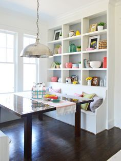 Both built-in bookcases and banquettes are meant to be directly next to the wall, offering as much seating, storage, and open floor space as possible — so when combined, they're a like small dining room superhero.  See more at Young House Love »