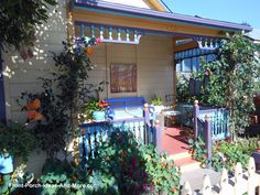 One of my faves - sweet cottage-style porch with such vibrant colors and gingerbread trim. front-porch-ideas-and-more.com #cottage