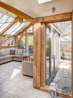 Light and Spacious Interior of Contemporary Green Oak Framed Extension in Devon by Carpenter Oak Ltd room extensions conservatory Timber and Oak Frame Design by the Experts Chalet Extension, Cottage Extension, Oak Frame House, A Frame Cabin, Garden Room Extensions, House Extensions, Oak Framed Extensions, Timber Frame Homes, Future House