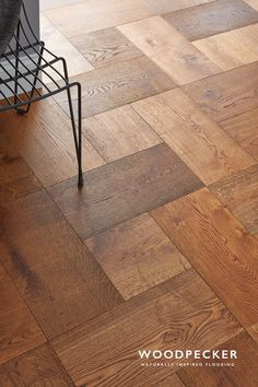 Take a stroll across the warm, fiery tones of this unusual parquet floor. Love its rich caramel tones and rustic details. Get a free sample.