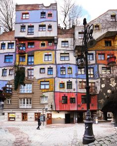 Hundertwasserhaus - an apartment building in Vienna, Austria, built after the idea and concept of Austrian artist Friedensreich Hundertwasser with architect Joseph Krawina as a co-author. This expressionist landmark of Vienna is located in the Landstraße district on the corner of Kegelgasse and Löwengasse ( Mehmet Sert)