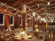 Swag lights in rafters & estate table placement