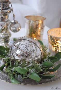 silver balls with greens and candlelight perfect centerpiece for Christmas
