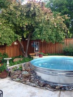 """(Image Link)Above ground pools are a great way to beat the heat and they give you a cool place to hang during those long summer days, but most above ground pools look pretty crappy compared to these shiny stock tank pools.(Image Link)It's the pool trend you're sure to see in backyards across America this summer, whether set up neatly on the patio like the photos above or just placed out back like a """"hillbilly swimming pool"""". My husband made a Hillbilly Swimming Pool. . . . #..."""