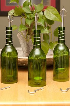 Wine bottle candle Holder on etsy. (That's kind of cool-using kitchen whisks to hold the candle inside the wine bottle. Wine Bottle Corks, Glass Bottle Crafts, Bottle Candles, Diy Bottle, Bottle Lights, Bottles And Jars, Glass Bottles, Beer Bottles, Recycled Bottles