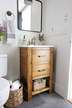 A small bathroom is made over into a classic, modern rustic bathroom on a budget! This small bathroom makeover used lots of budget-friendly DIY projects to transform a half bathroom! Bathroom Vanity Designs, Rustic Bathroom Vanities, Bathroom Design Small, Budget Bathroom, Bathroom Renovations, Bathroom Storage, Small Bathrooms, Bathroom Ideas, Vanity Bathroom