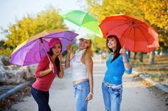 Nice pose to do with friends  & with close relatives   Image of 'Three fashion teenage girls posing with colorful umbrellas in autumn park'