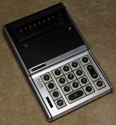 Vintage Sanyo Electronic Pocket Calculator, Model ICC-0081, 8 Digit Tube, Flip-Up Lid Over The Display, Made In Japan, Original Price = 495 USD, Circa 1971.