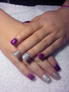 Purple, bling and stamp nails