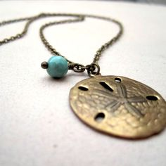 Sand Dollar Necklace - Brass & Turquoise. 18.00, via Etsy.