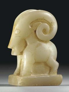 A SOUTH ARABIAN CALCITE-ALABASTER IBEX CIRCA 1ST CENTURY A.D.