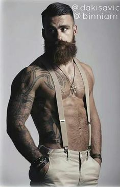 Beard, tattoos, suspenders, and muscles. Is he single though?