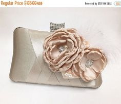 A personal favorite from my Etsy shop https://www.etsy.com/listing/157162107/wedding-clutch-bridal-clutch-champagne
