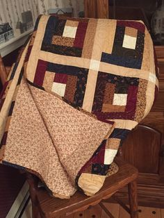 My 12th quilt - Moda Bakeshop pattern using Kansas Troubles Favorites layer cake; my 1st attempt at making ribbon binding which I love!