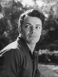 Actor Cornel Wilde Alone in Candid Portrait Outside