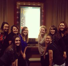fashion design and merchandising students with the Recollection poster at the Turning Stone Resort & Casino
