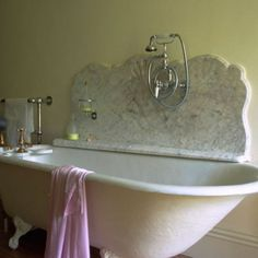 Beautiful Marble piece with an Vintage Claw foot Tub   21 Cool Bathroom Backsplash Ideas | Shelterness