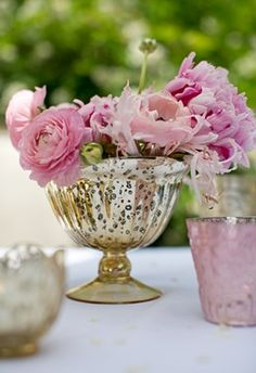 Gold Carraway compote vase filled with peonies & ranunculus.