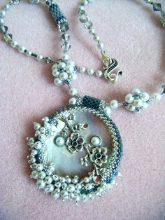 Center Mother of Pearl from Goodwill find then I beaded around it. One of my favorites! Sharon A. Kyser