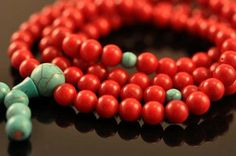 Coral and Turquoise Mala - Hinky Imports  This mala is made from coral and turquoise beads. There are 108 beads on this mala, and each bead is 7 mm wide. There are small, 5 mm spacer beads in turquoise on this mala, and there is a guru bead at the end of the mala. There are also 6 counting beads on the tassel. This mala was handmade in Nepal.