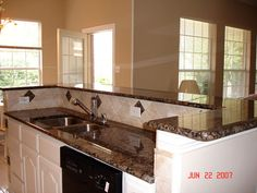 Best Baltic Brown Granite With White Cabinets Brown Cabinets 400 x 300