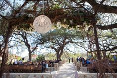 Look at that magnificent crystal ball | Sacred Oaks | Flora Fetish | Two Fish Photography | Camp Lucy | Wedding Venue | Destination Weddings | Hill Country | Weddings | Wedding Inspiration |