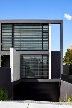 The Melbourne home that Architecton Director Nick Lukas designed for himself and his family balances the simplicity of rectilinear forms and raw materials such as concrete, steel and glass with elegant, detailed interiors. Externally, the architecture reads as a series of intersecting light and dark planes. Despite the abundance of glass, the front façade is deliberately closed, with a deep setback and double-height off-form concrete wall creating a sense of protection from the street.