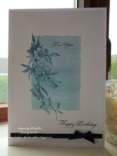 Rose Branch Border from Stampendous -  card: shades of blue are Tumbled Glass, Faded Jeans and Stormy Sky Distress inks, for the background with the text randomly stamped in Faded Jeans