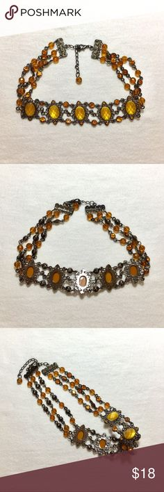 """Vintage Wide Gold Rhinestone Choker Vintage wide gold rhinestone choker is antiqued silver. There is 5 large stones on antiqued silver ovals that measure 1""""H. The large rhinestones are connected with 3 chains of beads & rhinestones. Excellent condition. Jewelry Necklaces"""