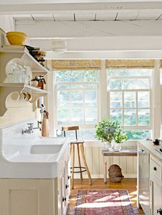 This homeowner designed her entire new kitchen, complete with a pine-topped island and open shelves, around this stunning farmhouse sink. These sinks were in everyone's house when I was growing up in NJ - wish I had one now. New Kitchen, Vintage Kitchen, Kitchen Dining, Kitchen Decor, Vintage Sink, Kitchen Sinks, Kitchen Mat, Kitchen Yellow, Kitchen Ideas