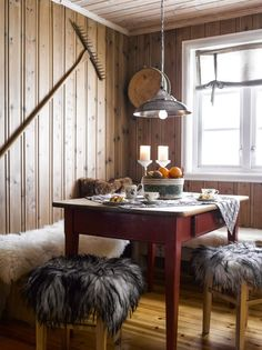 LUNK KITCHEN HOOK: Walls and ceilings in the new section are fitted with Tyrilin interior stain to give it a lighter feel. Riva was found in the barn. The skins are from local sheep. PHOTO: Per Erik Jæger Cabin Interiors, Rustic Interiors, Small Space Living, Small Spaces, Scandinavian Cabin, Cabins In The Woods, Rustic Decor, Decoration, Interior Design