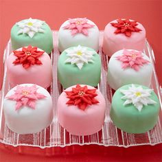 Pretty poinsettia blooms made in buttercream icing decorate these classic cakes. Petit fours are perfect for your holiday table and as gifts for friends and family.