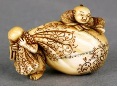 Netsuke Depicting Hotei with his Sack of Never-Ending Riches and a Chinese Child ~ Ivory ~ Japan Signature: Hidemasa ~  Edo Period, 18th century