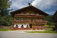 Storybook Swiss Chalet - love the exterior painting ...