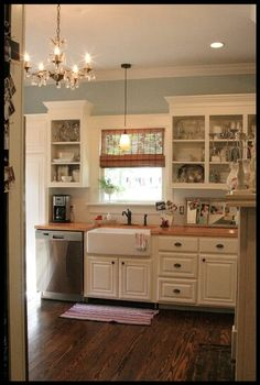 Bead board backsplash, white cabinets, dark wood floor, pretty wall color