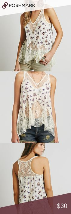 Free People 'Bell' Lace Trapeze Camisole Sold out online, 5 star top rated Free People product. Printed crinkly gauze trapeze cut cami with a romantic lace racerback, hem, and neckline. Racerback. Free People Tops Tank Tops