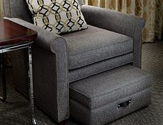 A classic seat with feel of a tailored suit ~ integrated footstool slides out so you can put your feet up
