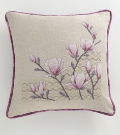Angela Poole designed a set of three gorgeous magnolia cushions for CSC 194 Get this project from issue 194 in a digital back issue from www.bit.ly/AppleCSCollection or www.zinio.com/crossstitchcollection