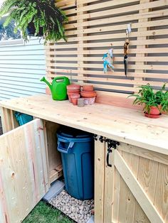 Learn how to build the mother of all potting benches! This hefty potting bench has shelving for storage, two garbage can enclosures hidden behind doors, tons of work surface, slats for hanging tools, and a roof! See more pics and details on our blog! http://realitydaydream.com/potting-bench-with-hi