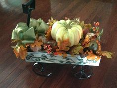 Hand painted wagon filled with Fall Foliage