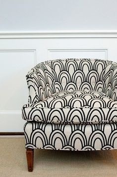 Love the navy and white upholstery on this chair. (Would compliment shape of rounded back tufted sofa)